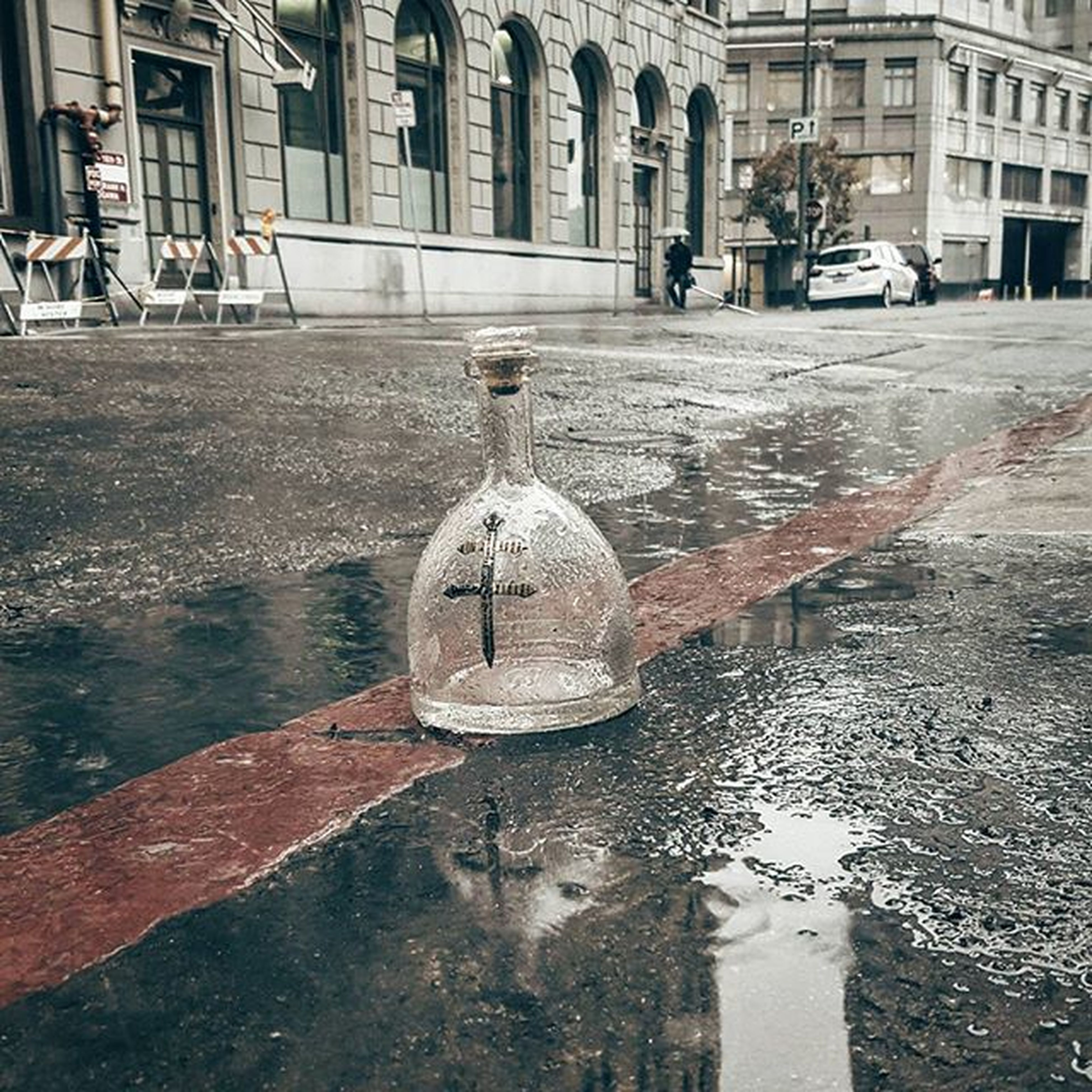 Things left on streets. I bet this bottle has a great story Oakland Rain Emptybottle Downtown Crystal Streetfinds Streets Thingsleftbehind