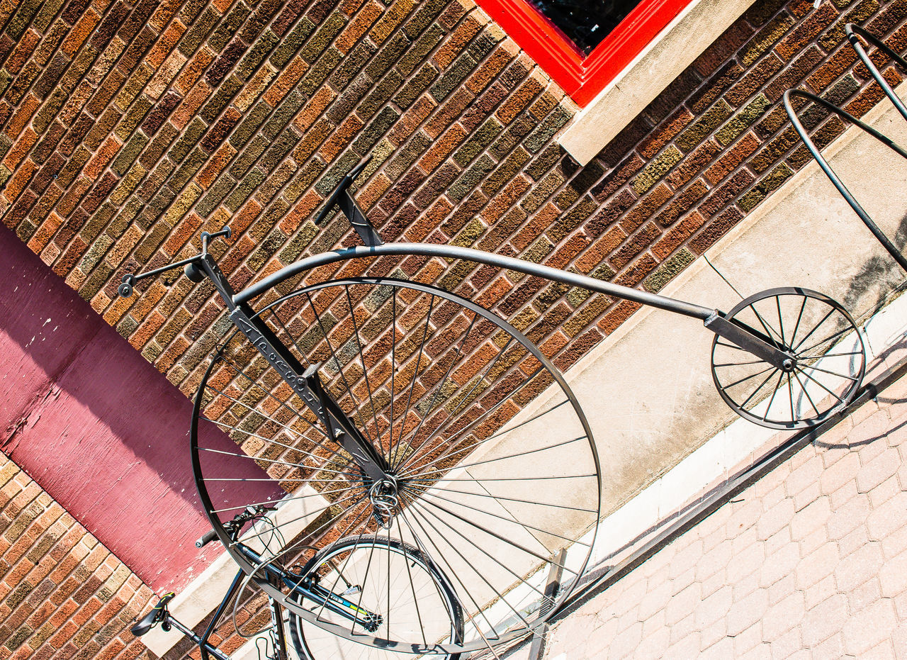 Angle Bicycle Bicycle Stand Bicycle Wheel Bicycles Brick Wall Building Exterior Circle EyeEm Best Shots Metal Old And New Parked Parked Bike Red Ride Spokes Street Street Photography Streetphotography This Week On Eyeem Transportation Unicycle Vintage Wheels Windows