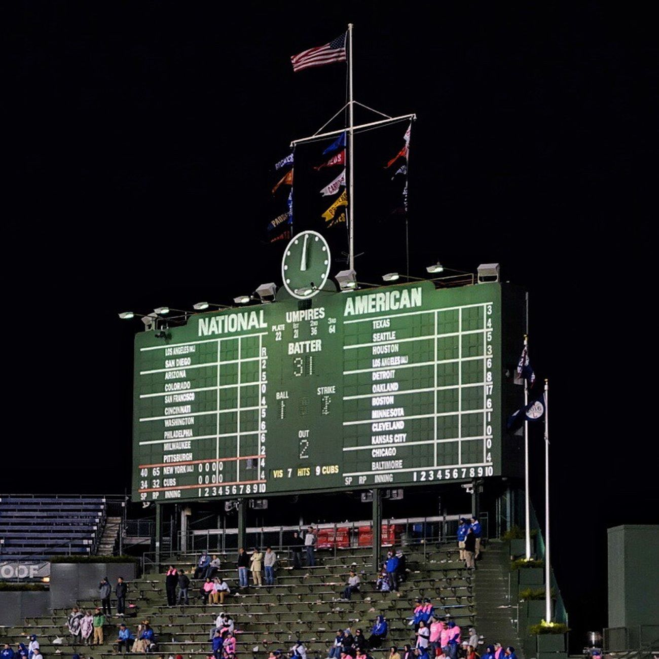 The clock strikes midnight and the game goes on into the bottom of the 15th inning tied at 4 Chicago Cubs  Yankees Baseball