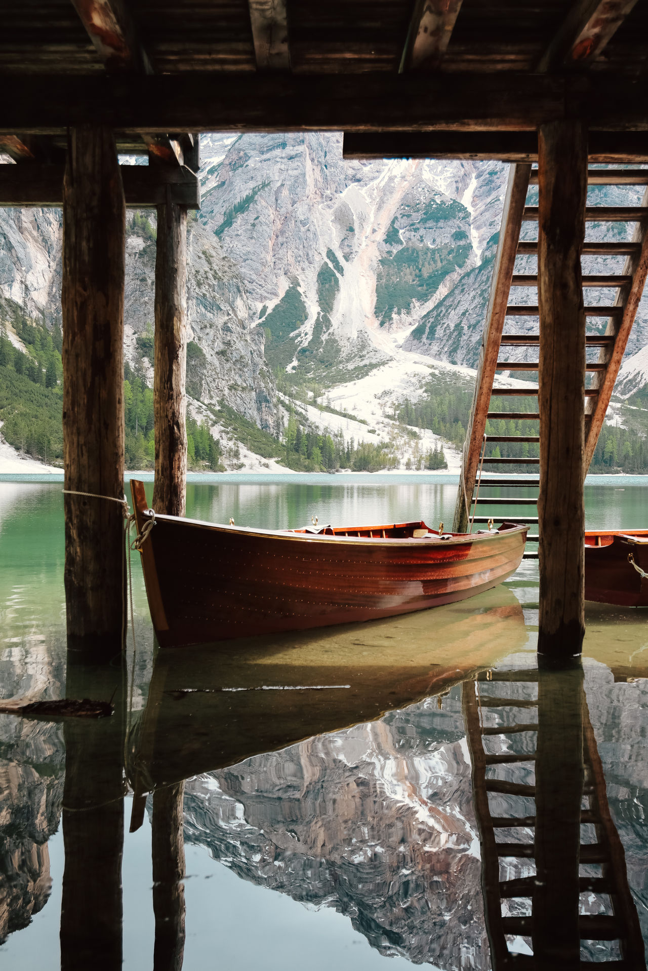 Beauty In Nature Beneath Boat Braies Cold Temperature Dock Ladder Lake Lakescape Mountain Mountain Range Nature Nature Photography Nautical Vessel No People Outdoors Reflection Sail Sky Snow The Great Outdoors - 2017 EyeEm Awards Tranquil Scene Tranquility Water Wooden