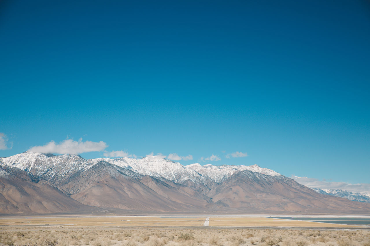 Arid Climate Beauty In Nature Blue California Coso Day Death Valley Desert Landscape Mountain Mountain Range Nature Nature No People Outdoors Physical Geography Road Roadtrip Salt Flat Scenics Sky Snow Snowcapped Mountain Tranquil Scene Tranquility