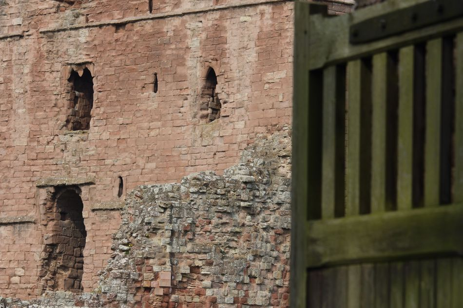 Looking through the gate Architecture Built Structure Building Exterior Weathered Day No People Outdoors Textured  Close-up Northumberland Looking Through Castle Historical Building Close Up