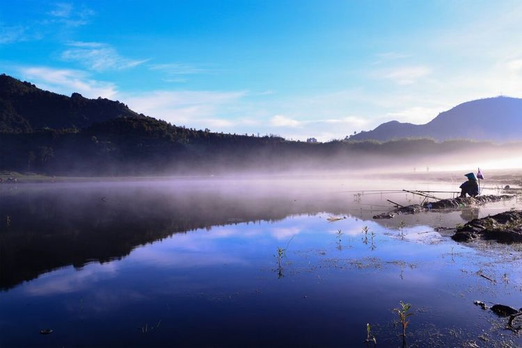 """Dringo Lake , a Beautiful place in a land called """"khayangan"""" or Heaven ~ Landscape Reflection Calm Blue Mountain Silhouette Traveling Dieng INDONESIA"""
