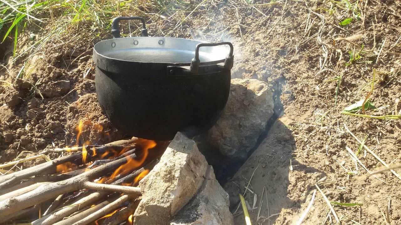 no people, heat - temperature, high angle view, outdoors, day, food and drink, field, sunlight, camping stove, nature, close-up