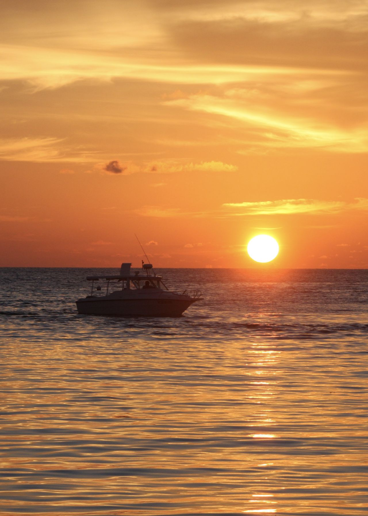 golden hour, sunset on the maldives Beauty In Nature Colors Golden Hour Holiday Horizon Over Water Jet Boat Light Maldives Nature Nautical Vessel Orange Color Outdoors Reflection Relax Sailing Scenics Sea Silhouette Sky Sun Sunset Tranquil Scene Tranquility Travel Water