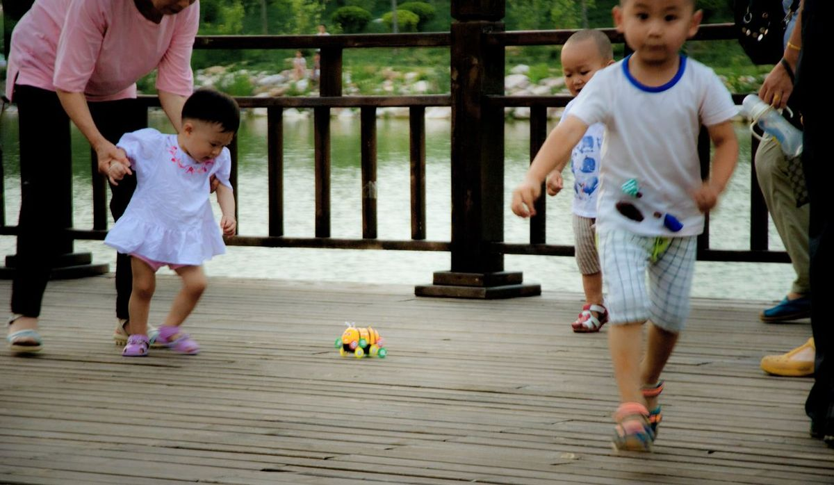 Childhood Leisure Activity Lifestyles Girls Full Length Casual Clothing Playing Shoe Innocence Person Boardwalk Enjoyment Day Fun Children Only Well-dressed Wood Paneling In Front Of Walk By Blind Shots Hometown Toy Running Babyboy Summer Time  Summer Memories 🌄