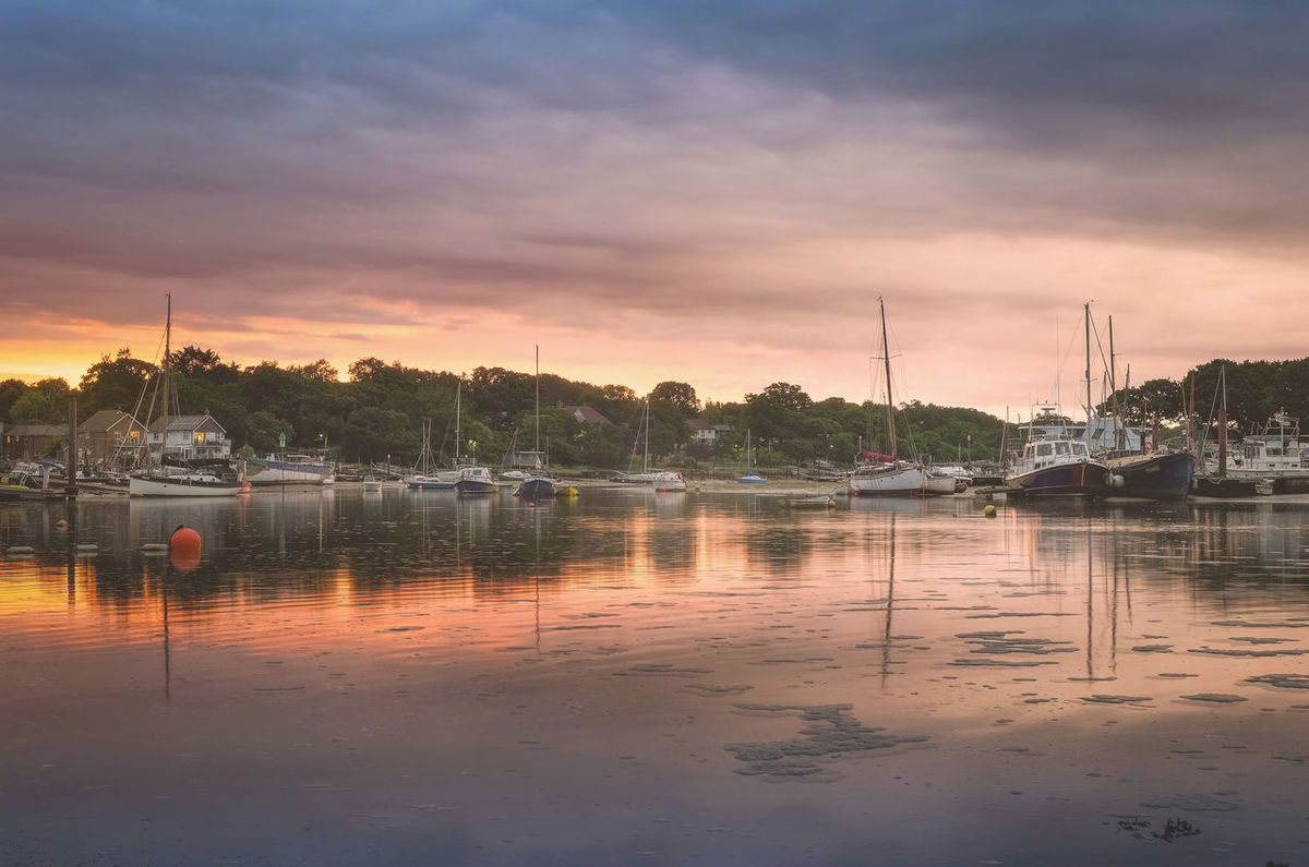 Stormy skies during a winters sunset on Wootton Bridge, Isle of Wight. Islandlife Isle Of Wight  Keith Morgan Moored Nautical Vessel Reflection Sky Stormy Sky Sunset Water Wootton Wootton Bridge