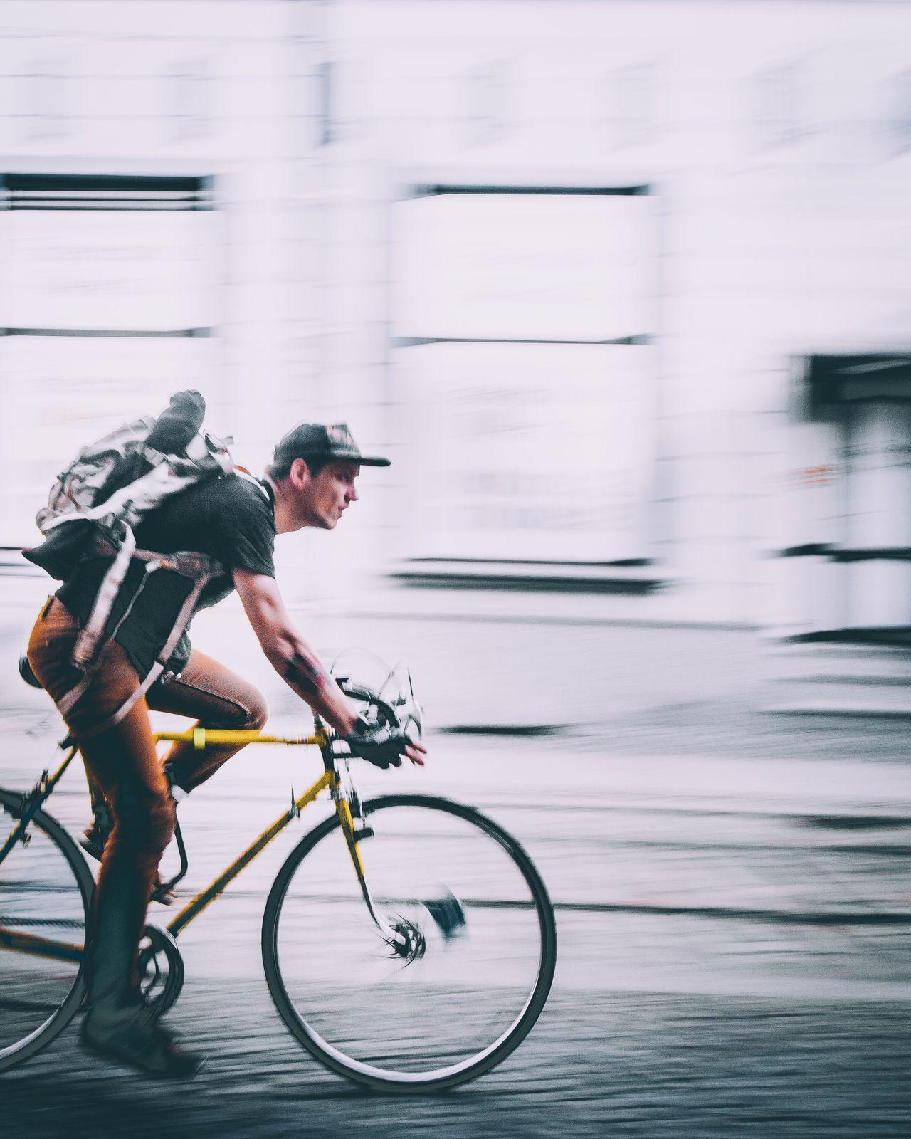CyclingUnites Transportation Bicycle Mode Of Transport Land Vehicle Leisure Activity On The Move Helmet Motion Lifestyles Road Enjoyment Headwear Travel RISK Men Riding Full Length City Life City Street Crash Helmet