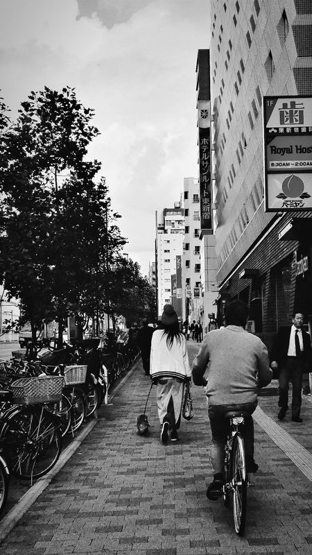 Pavement Shinjuku Dog Walking Tokyo Japan Travelphotography Streetphotography Bnw Bnwphotography Bnwcollection Bnw_captures Bnw_world Bnw_streetphotography Bnw_tokyo Bnw_japan