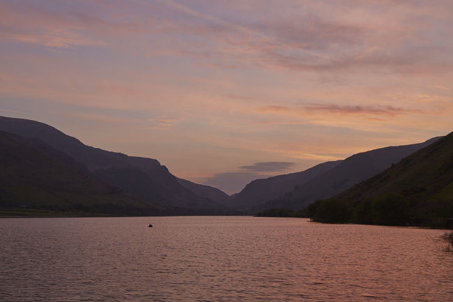 Beauty In Nature Cloud Cloud - Sky Mountain Mountain Range Nature No People Outdoors Silhoutte Sky Sunrise Tranquil Scene Wales Water