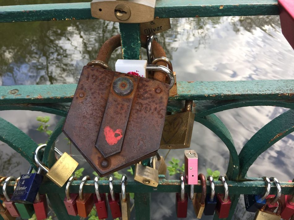 Padlock Lock Love Lock Security Protection Safety Railing Metal Rust Rusty Love Eyem Best Shots EyeEm Best Shots Detail Eyemphotography Photography Rustic Outdoors Day Hanging Close-up Hope Water No People Sky