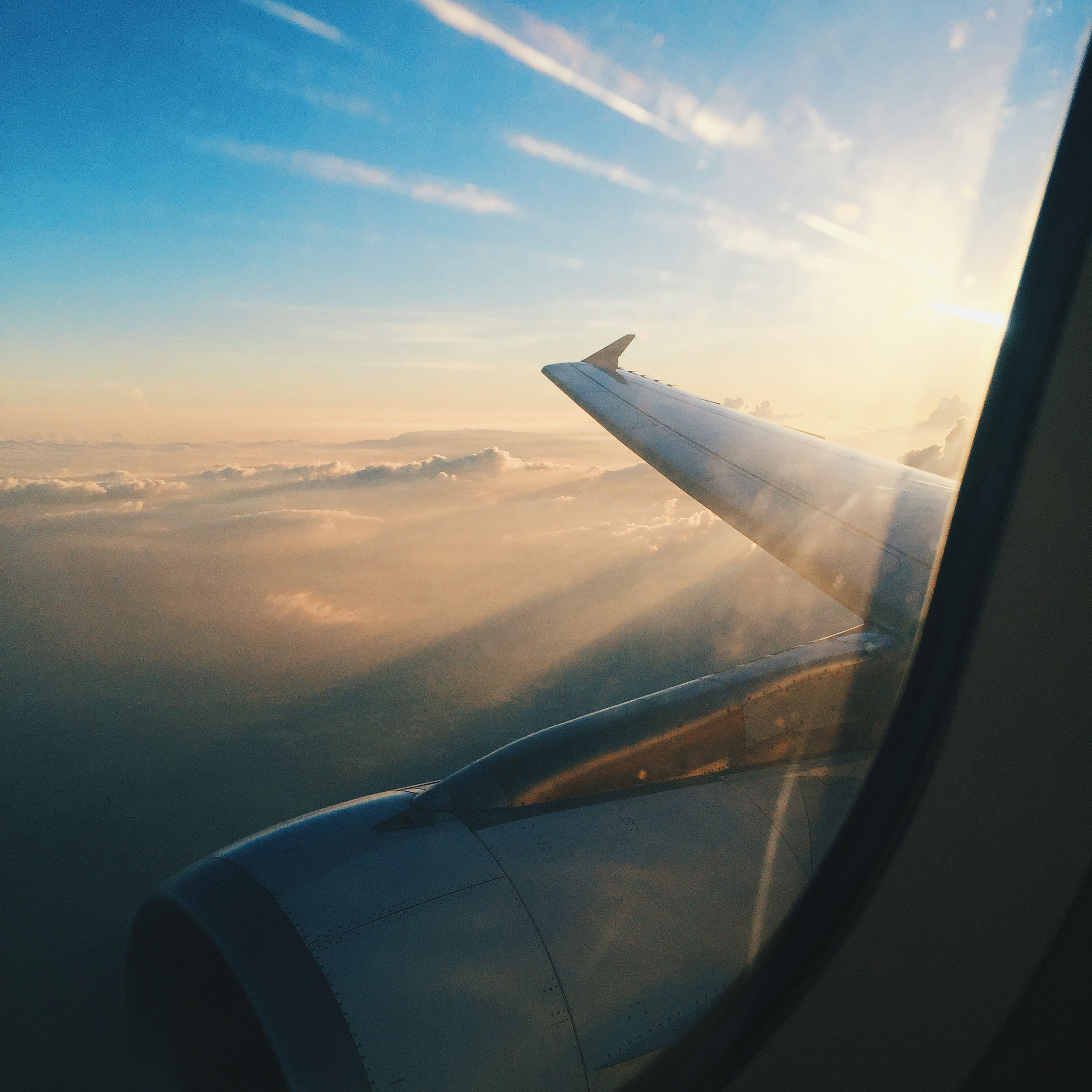 airplane, air vehicle, aircraft wing, transportation, mode of transport, aerial view, flying, part of, cropped, sky, travel, window, vehicle interior, journey, mid-air, cloud - sky, airplane wing, on the move, public transportation, glass - material