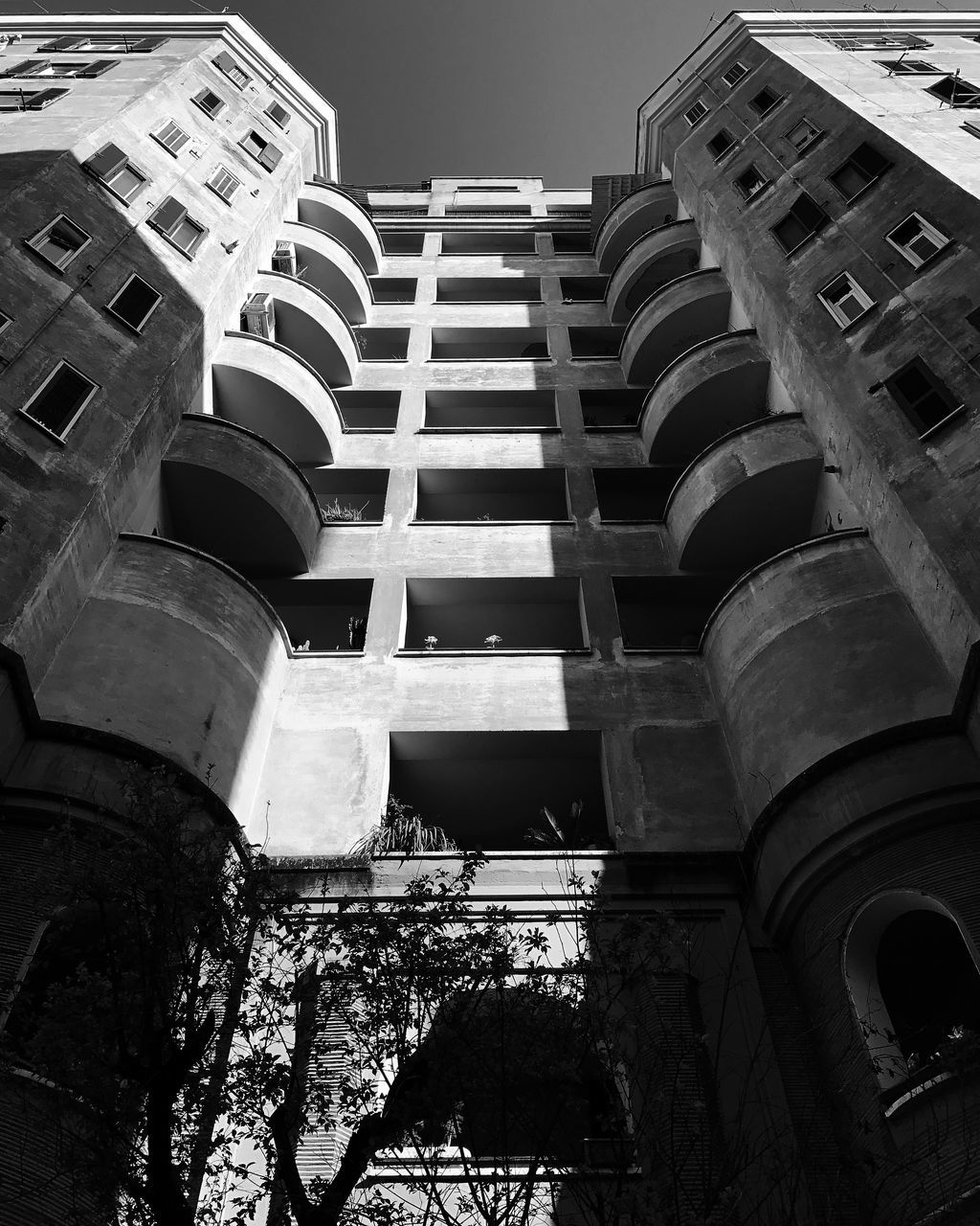 architecture, built structure, low angle view, building exterior, outdoors, day, no people, city, sky