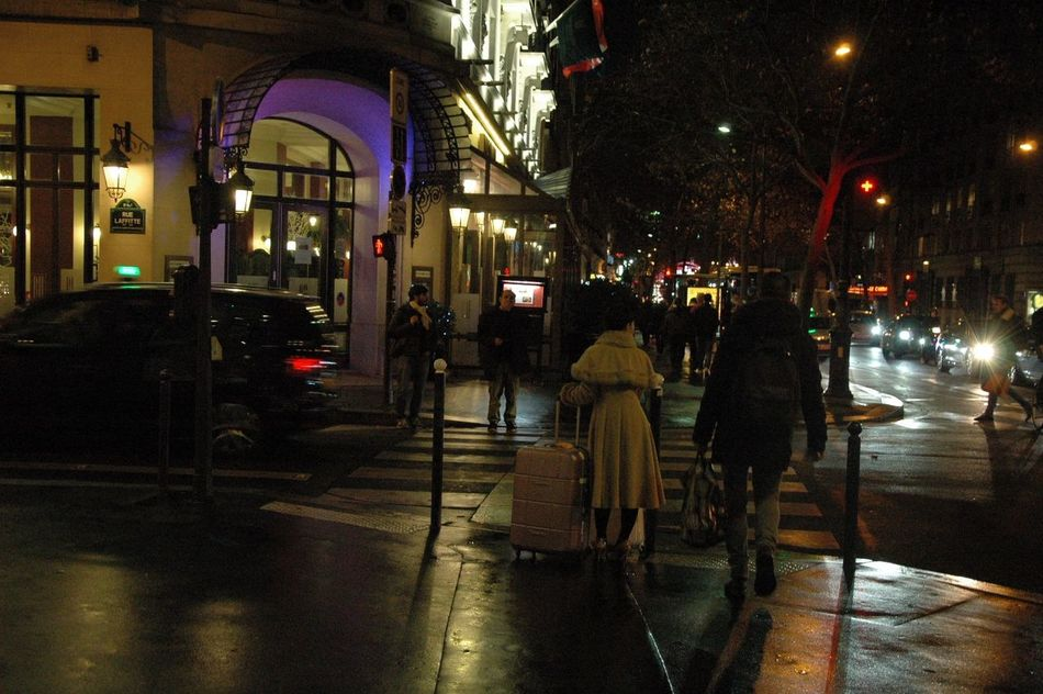 Alone City Crossing The Street Grands Boulevards Luggage Lush Foliage Night Paris Paris By Night Rain Reflection Stop Street Street Lights Street Photography Streetphotography Tableau Traffic Wandering Winter Woman