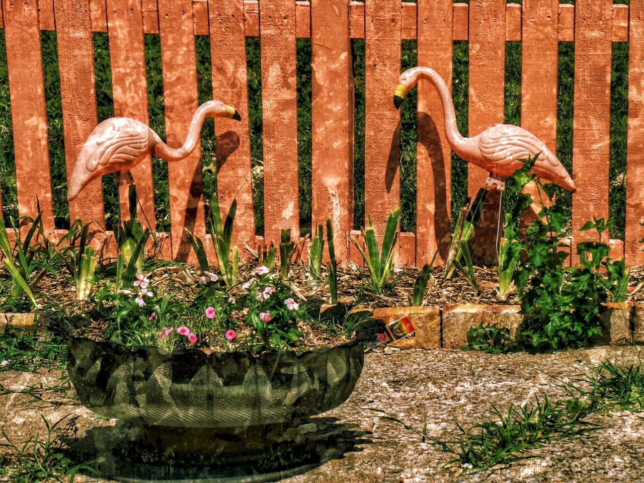 Flamingo Statue And Potted Plant In Park