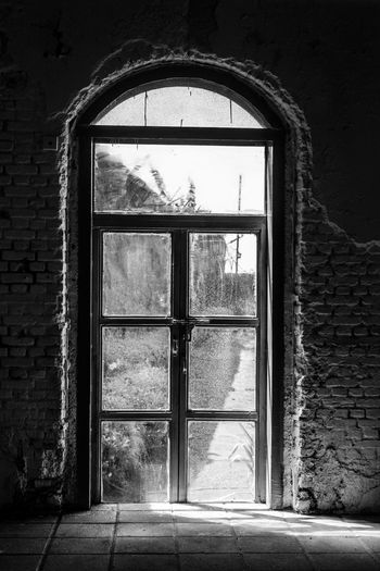 Mills of broken dreams. Closed doors. So many untold stories. The sun still does its job, shinning bright, spreading rays of hope. One closed door. Million other open. Mukeshmills Window Indoors  Built Structure Architecture Doors Black & White Outdoor Pictures Sunlight Architechturephotography Rayofhope Rayofsunshine First Eyeem Photo Canon Canonlove