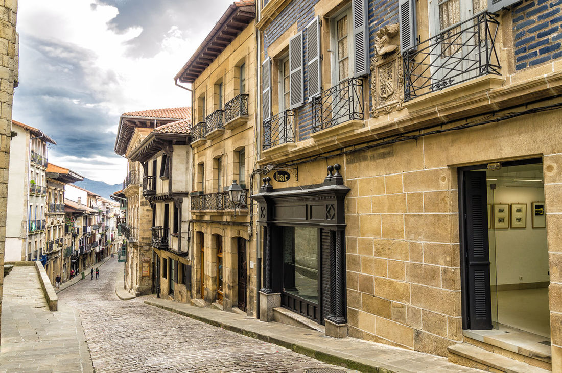 Street in european historical city centre Architecture Building Exterior Built Structure Centro City Day Footpath Historical Hondarribia Long Narrow No People Outdoors Residential Building Residential District Residential Structure Sky Street Streetphotography The Way Forward Walkway Window
