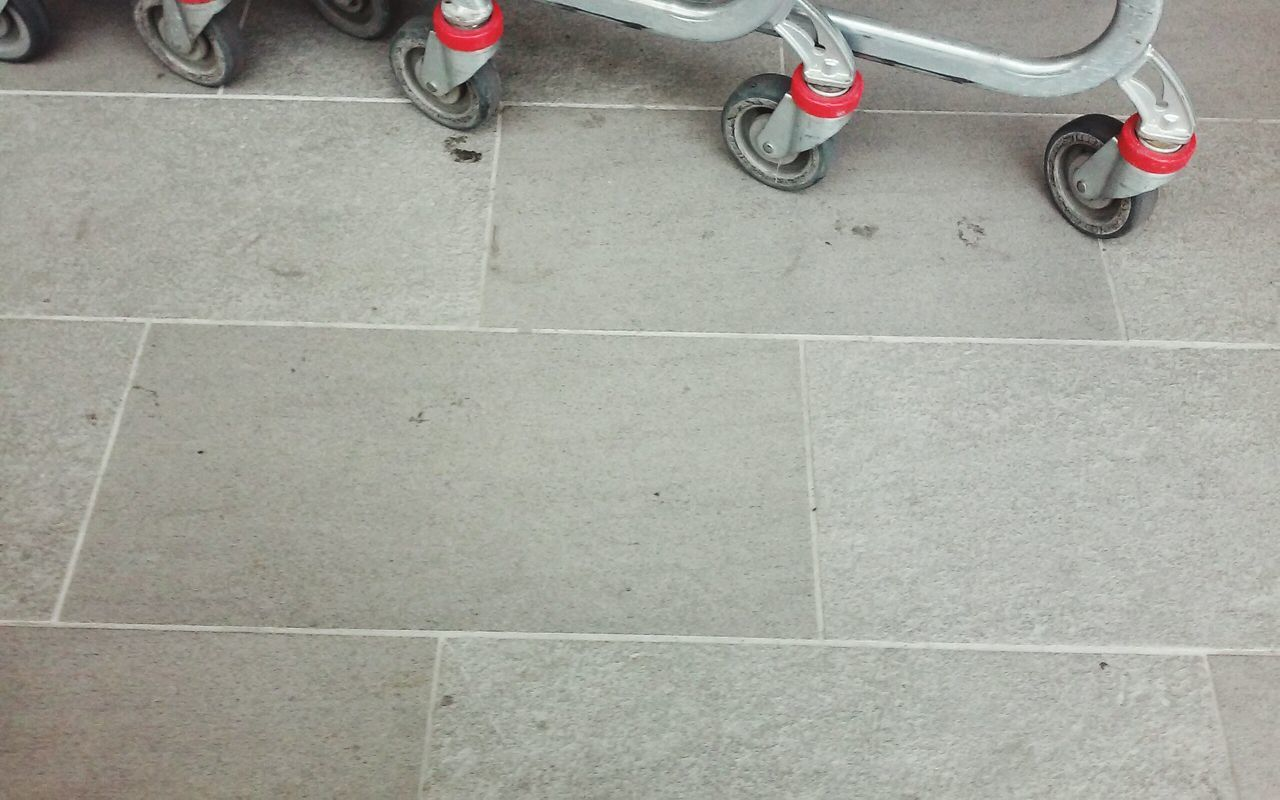 tiled floor, transportation, shoe, low section, high angle view, bicycle, stationary, tile, day, no people, outdoors