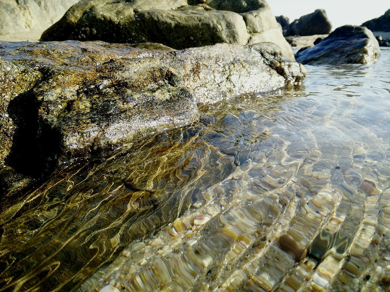 Nature Beach Rock - Object Outdoors No People Day Textured  Sea Beauty In Nature Tranquility Water Scenics Hot Spring Beauty In Nature Outdoor Photography Outdoor Beauty Outside Photography Low Angle View Tranquil Scene Freshness Close-up Portugal Shotononeplus Onepluslife Oneplusonephotography