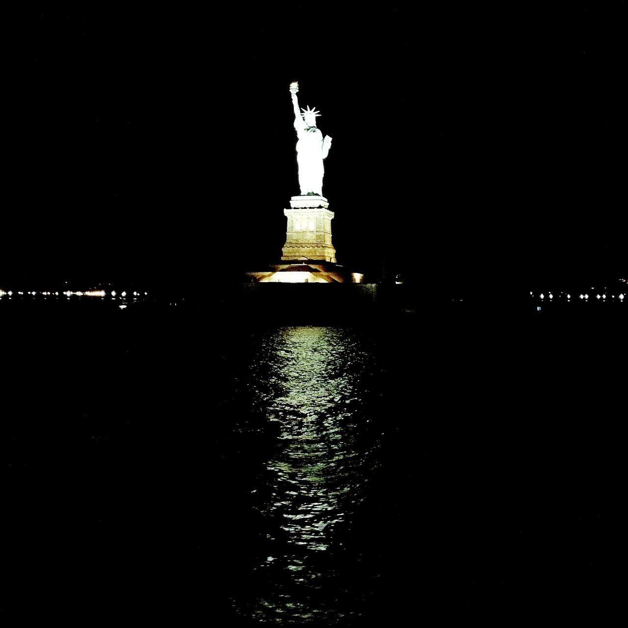 statue, night, water, human representation, female likeness, sculpture, illuminated, no people, travel destinations, outdoors, travel, architecture, sky