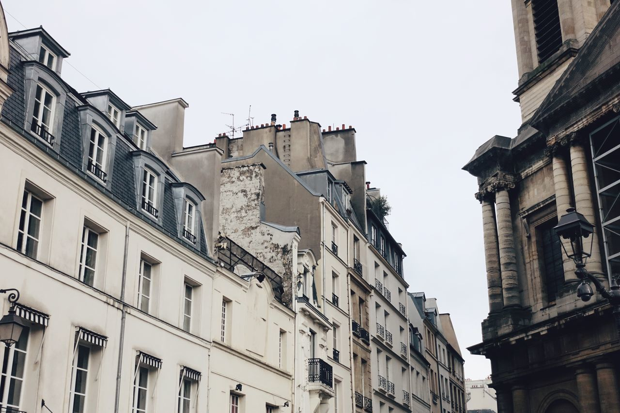 the Colors of Paris Architecture Building Building Exterior City City Life Cityscape Cloud - Sky Cloudy Colors Europe Gray Lifestyles Outdoors Paris Perspective Rain Rainy Days Sky Street Streetphotography Style The City Light Window Winter