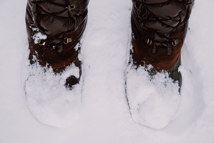 warm winter boots in the snow Boots Warm Clothing Winter Foot Wear  Feet Snow Snow Covered Snowcapped Snow Winter Cold Temperature Human Body Part Winter Sport Day Close-up Low Section Outdoors One Person Adult People Nature