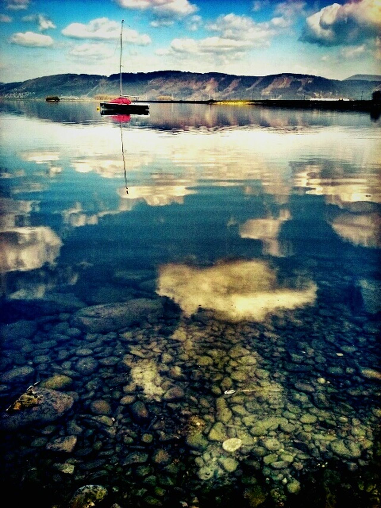 Riverscape Landscape Landscape Reflecting In Mirror Ship Calm Water Mountains Sky And Clouds