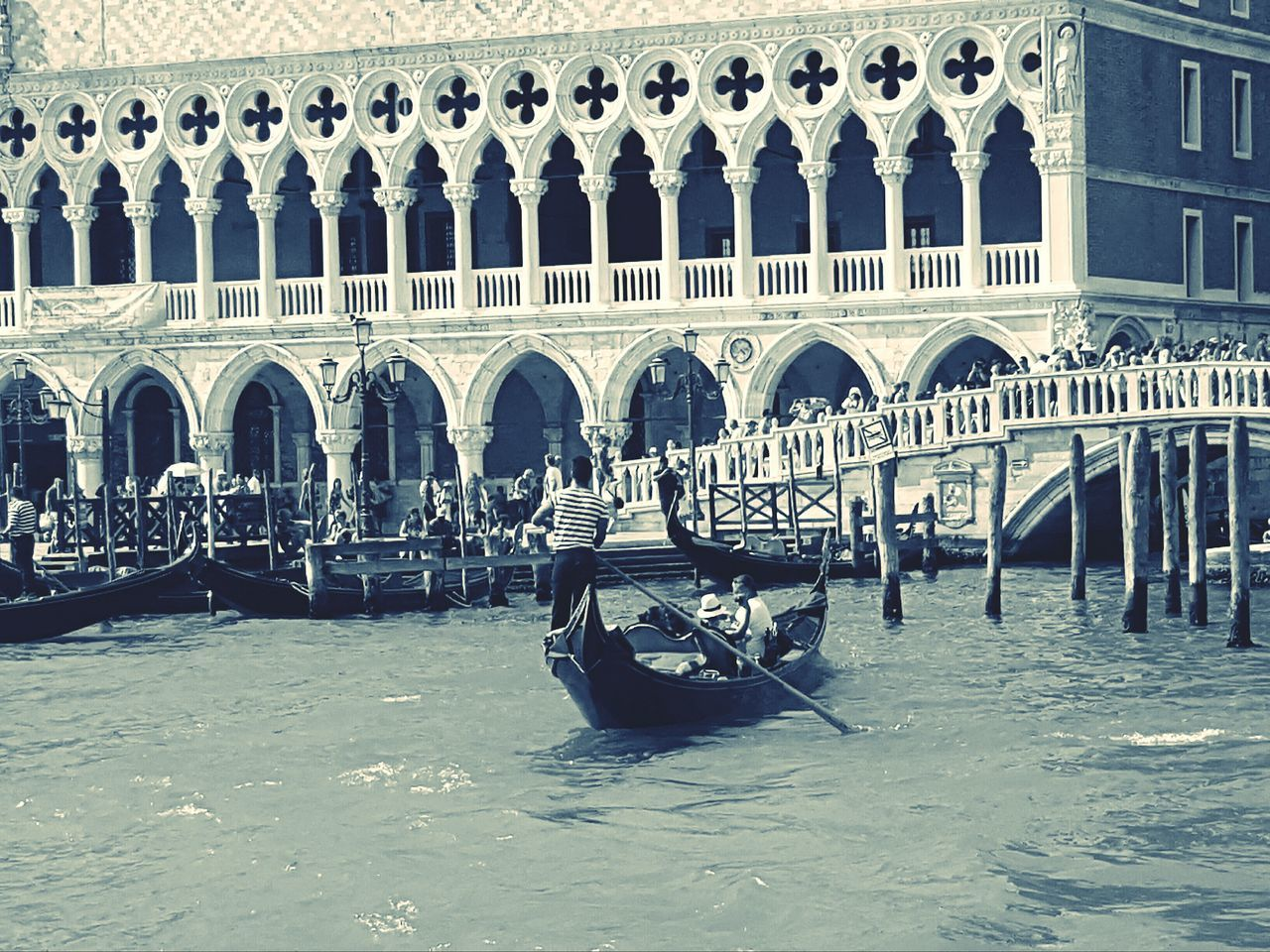 gondola - traditional boat, canal, water, travel destinations, tourism, arch, architecture, transportation, travel, nautical vessel, waterfront, gondola, wooden post, day, built structure, outdoors, gondolier, no people