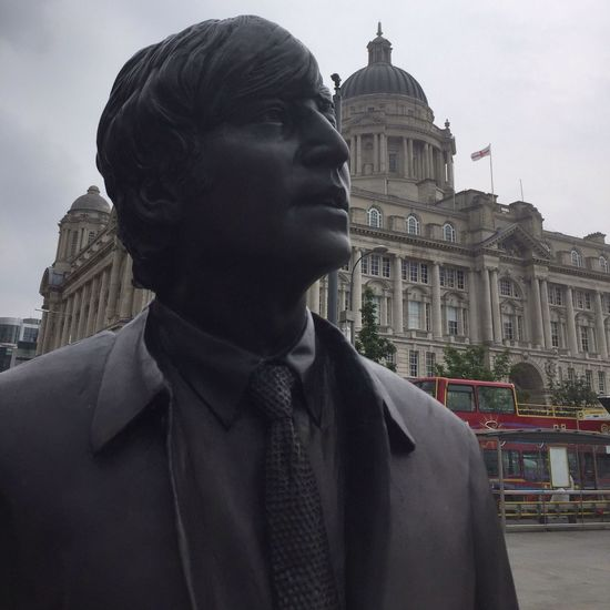 The Beatles Statue with The Royal Liver Building in the background. Liverpool pierhead. U.k Architecture Building Exterior Built Structure Statue Travel Destinations History Sculpture Government Day Outdoors One Person Real People City Close-up Library Sky People Street Photography John Lennon