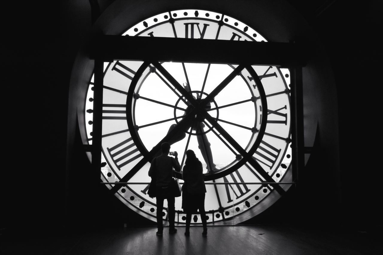 clock, time, clock face, roman numeral, minute hand, standing, hour hand, indoors, real people, travel, men, day, silhouette, travel destinations, lifestyles, one person, people