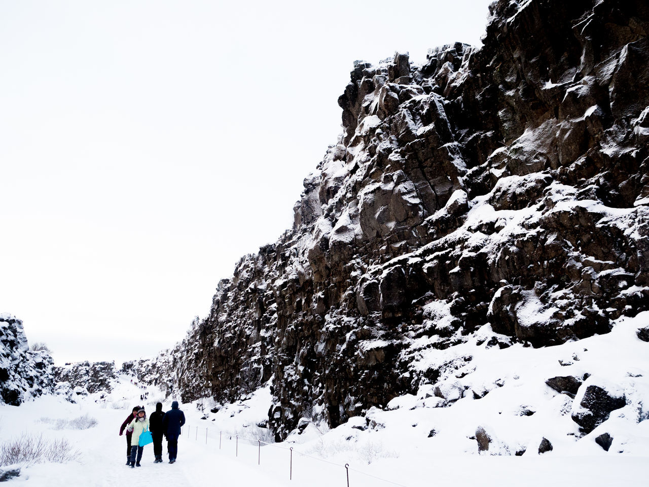 Beauty In Nature Cliff Cold Temperature Covering Day Full Length Iceland Landscape Leisure Activity Mountain Nature Non-urban Scene Outdoors Scenics Season  Snow Snow Covered Tourism Tranquil Scene Tranquility Weather Winter