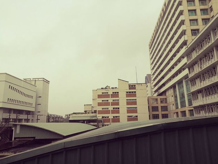 Building in rainy day. Architecture Building Exterior Built Structure City Residential Building Building Sky Development Office Building Tall - High City Life Outdoors Apartment Building Story Day Residential District Skyscraper Modern No People Exterior First Eyeem Photo