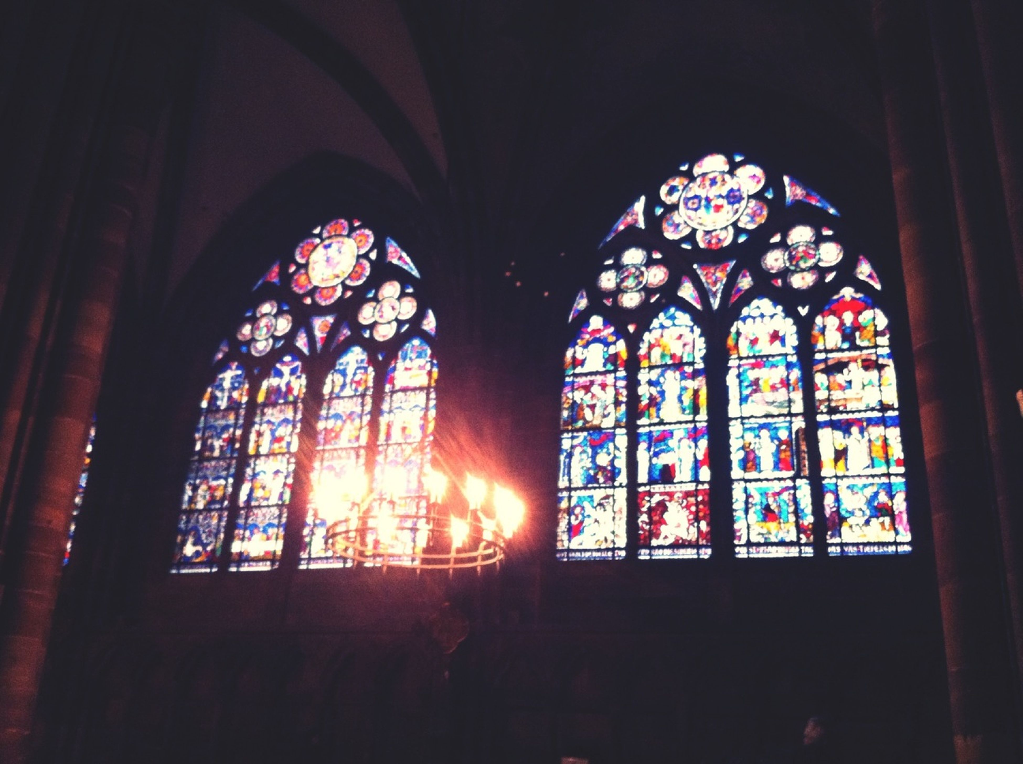 indoors, church, religion, place of worship, stained glass, spirituality, window, architecture, built structure, multi colored, glass - material, design, low angle view, arch, cathedral, pattern, ornate, ceiling