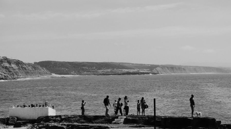 Beach Sea Nature Sand People Leisure Activity Vacations Sky Outdoors Water Women Day Adult Large Group Of People Mountain Horizon Over Water Adults Only Monochrome Photography Monochrome _ Collection Monochrome_life Monochrome Black And White Blackandwhite Photography Black And White Photography Rocks And Water