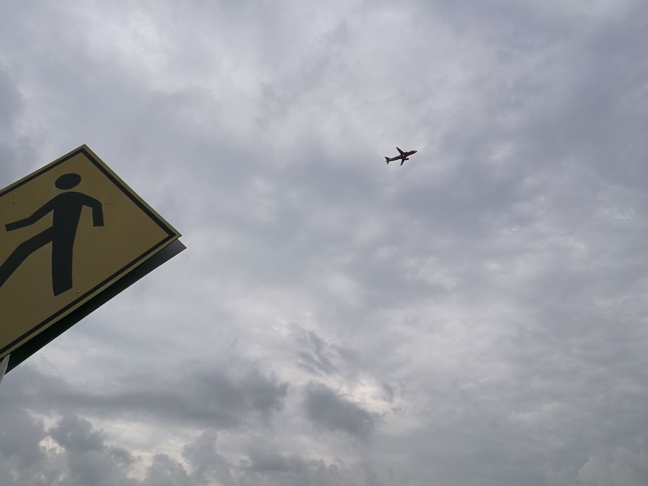 Crossover Adapted To The City Aeroplane Blue Sky Clouds And Sky Crossing Diamond Hanging Out Huawei P9 Leica Imagination Landscape Lieblingsteil Nature One Person Outdoors Park Photography Signboard Small Yellow