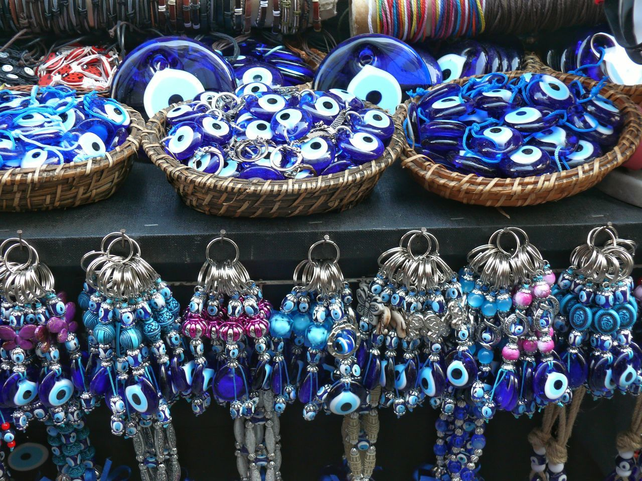 Showcase April Colors Blue Wave Blue Bead Group Of Objects Spirituality Spiritual Reflections Spiritualguidence Spiritual Beads Evil Eye Evil Eye Beads The Photojournalist - 2016 EyeEm Awards On The Way