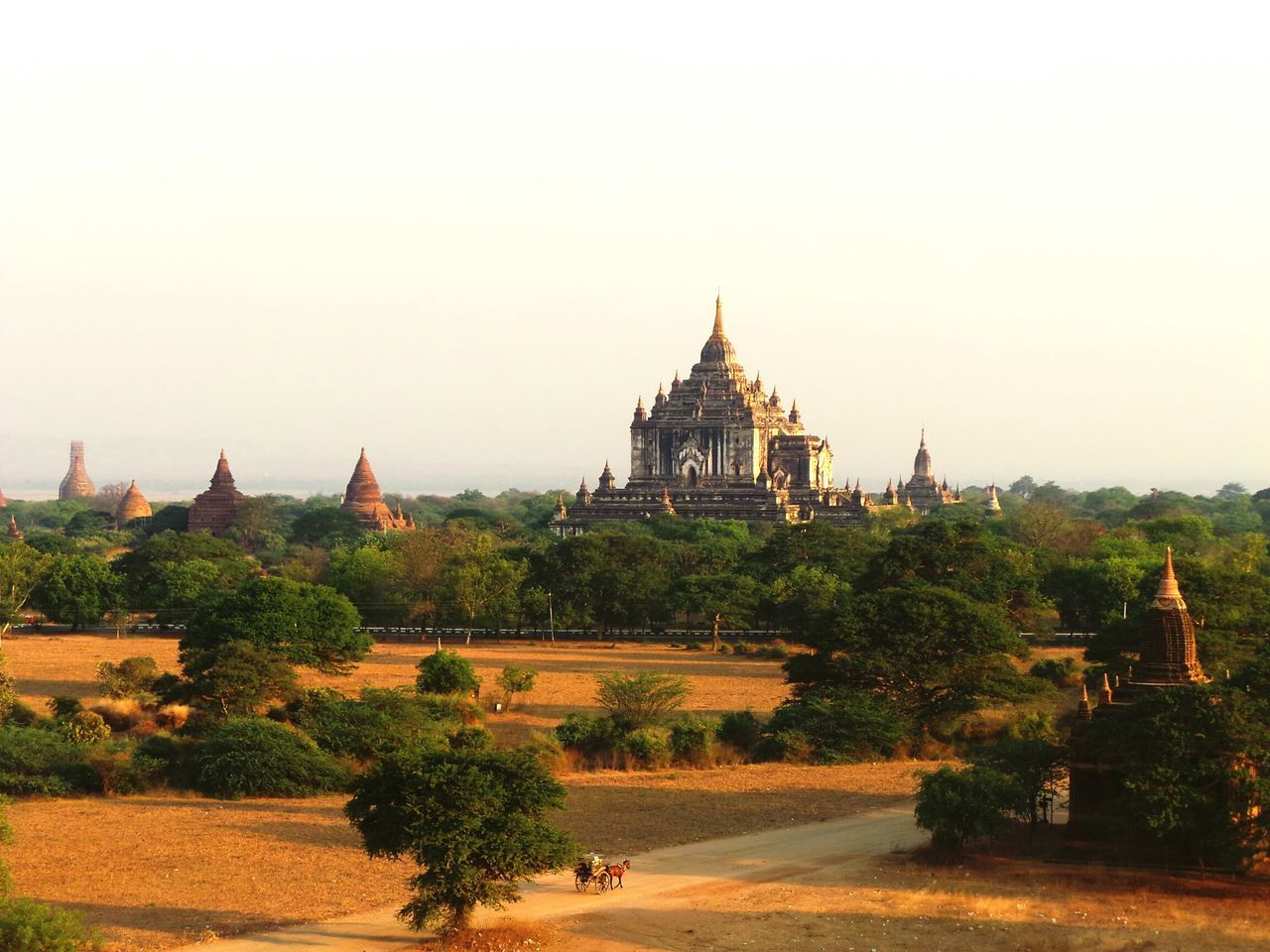 Back in time. Magical. Architecture History Tranquility Scenics The Past Place Of Worship Outdoors Horse Cart Horse Wagon Temple - Building Temple Landscape Myanmar Myanmararchitecture Bagan Bagan In Myanmar Back In Time Sunlight