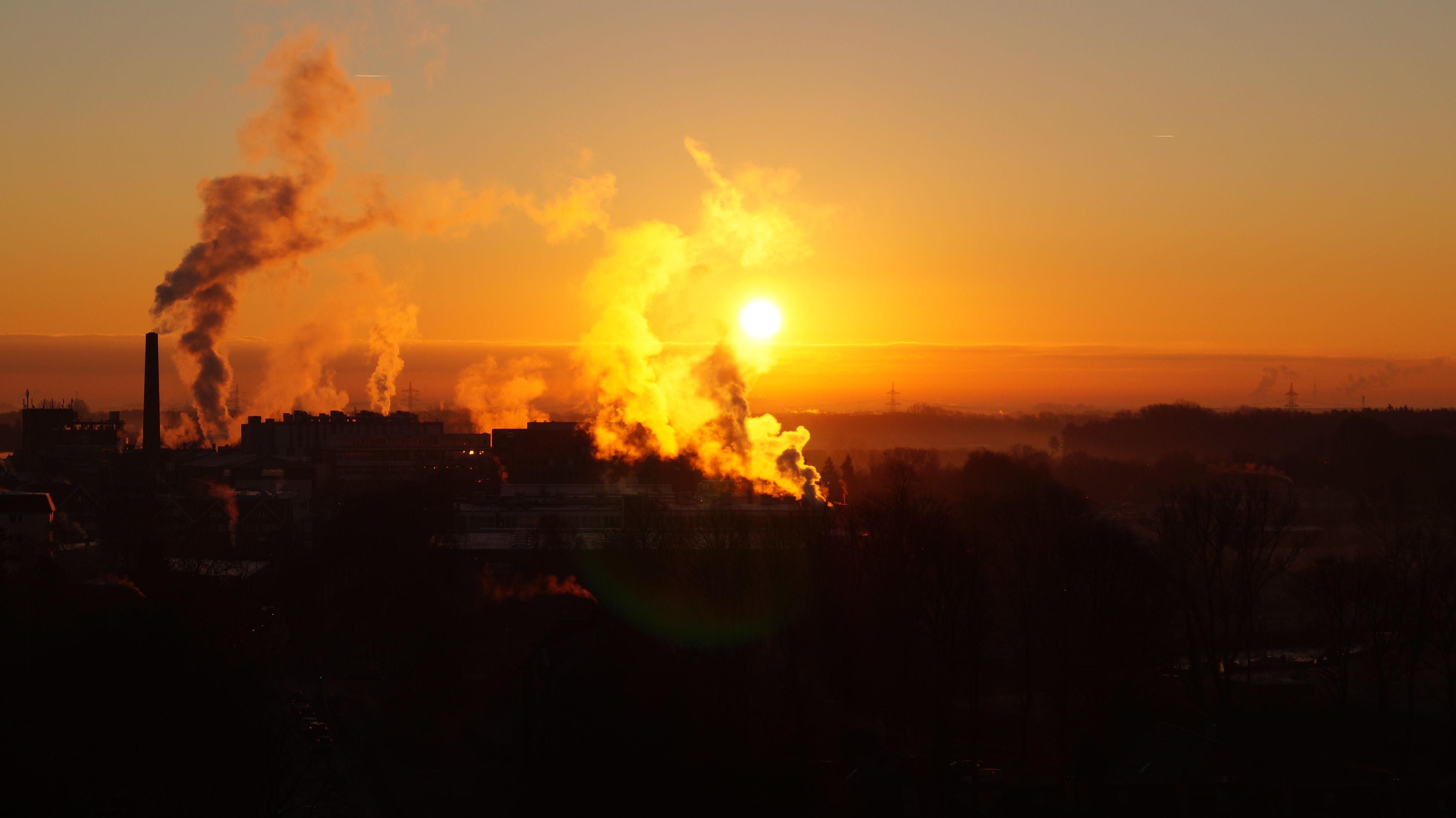 sunset, orange color, sky, silhouette, building exterior, landscape, scenics, cloud - sky, built structure, architecture, beauty in nature, nature, city, sun, outdoors, tranquil scene, cityscape, dusk, no people, idyllic