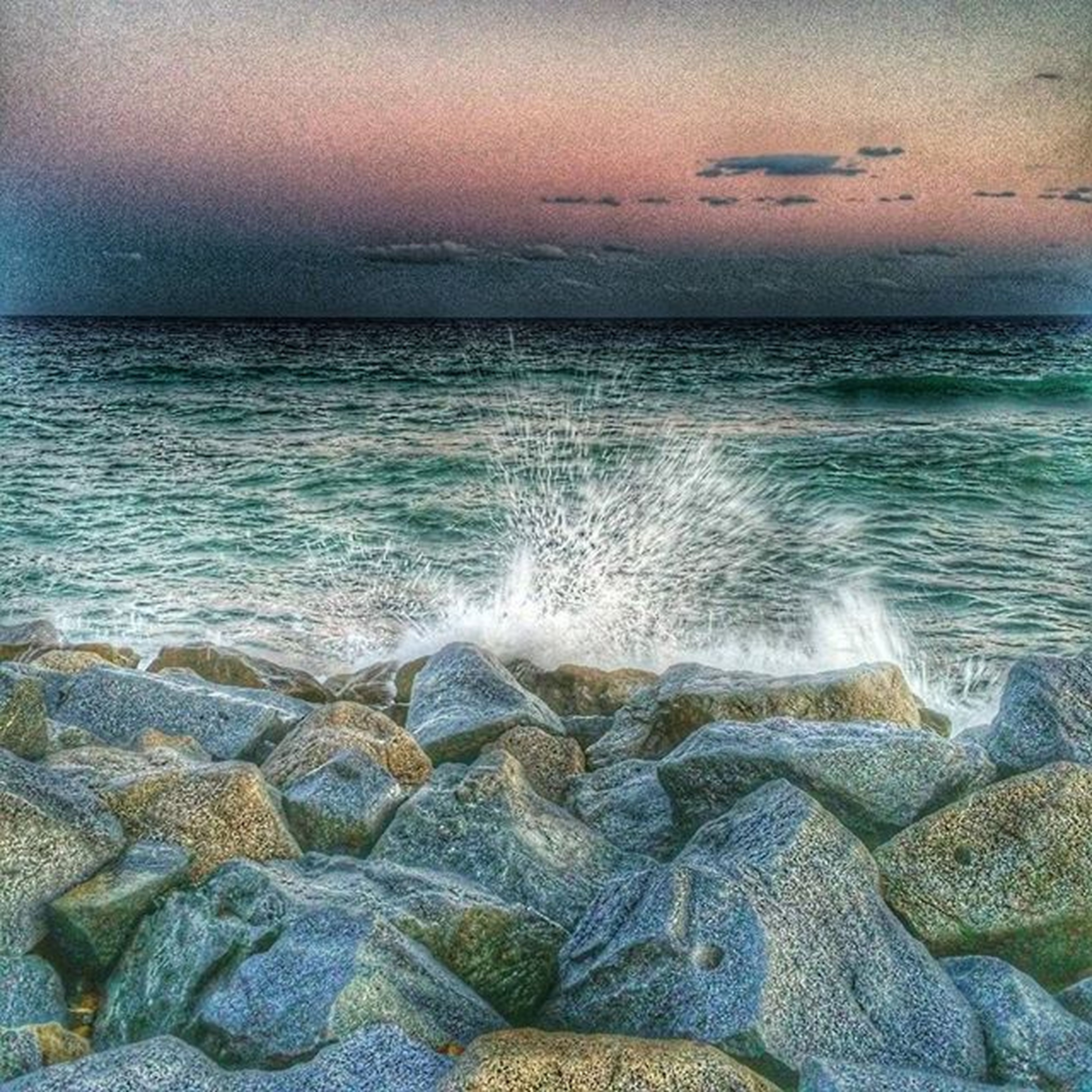 sea, water, horizon over water, wave, scenics, beach, beauty in nature, surf, rock - object, shore, nature, sky, tranquil scene, tranquility, motion, idyllic, splashing, stone - object, outdoors, no people