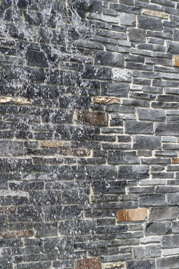 Abstract Architecture Backgrounds Blank Brick Wall Building Exterior Built Structure Close-up Day Full Frame No People Outdoors Pattern Stone Material Wall - Building Feature Water On The Wall