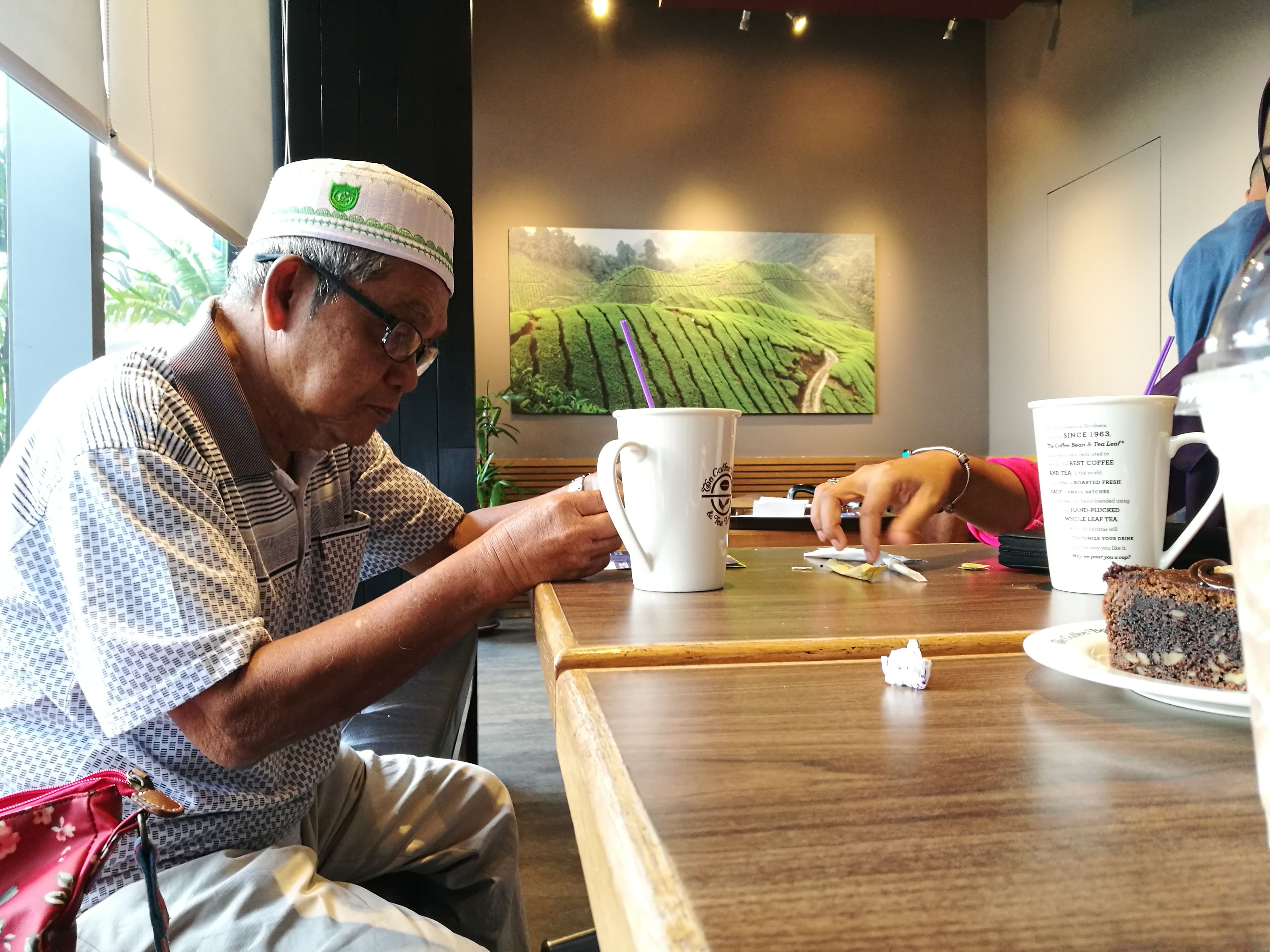 cafe, indoors, adults only, men, only men, young adult, sitting, adult, people, coffee shop, bakery, business finance and industry, table, eyeglasses, occupation, one man only, day