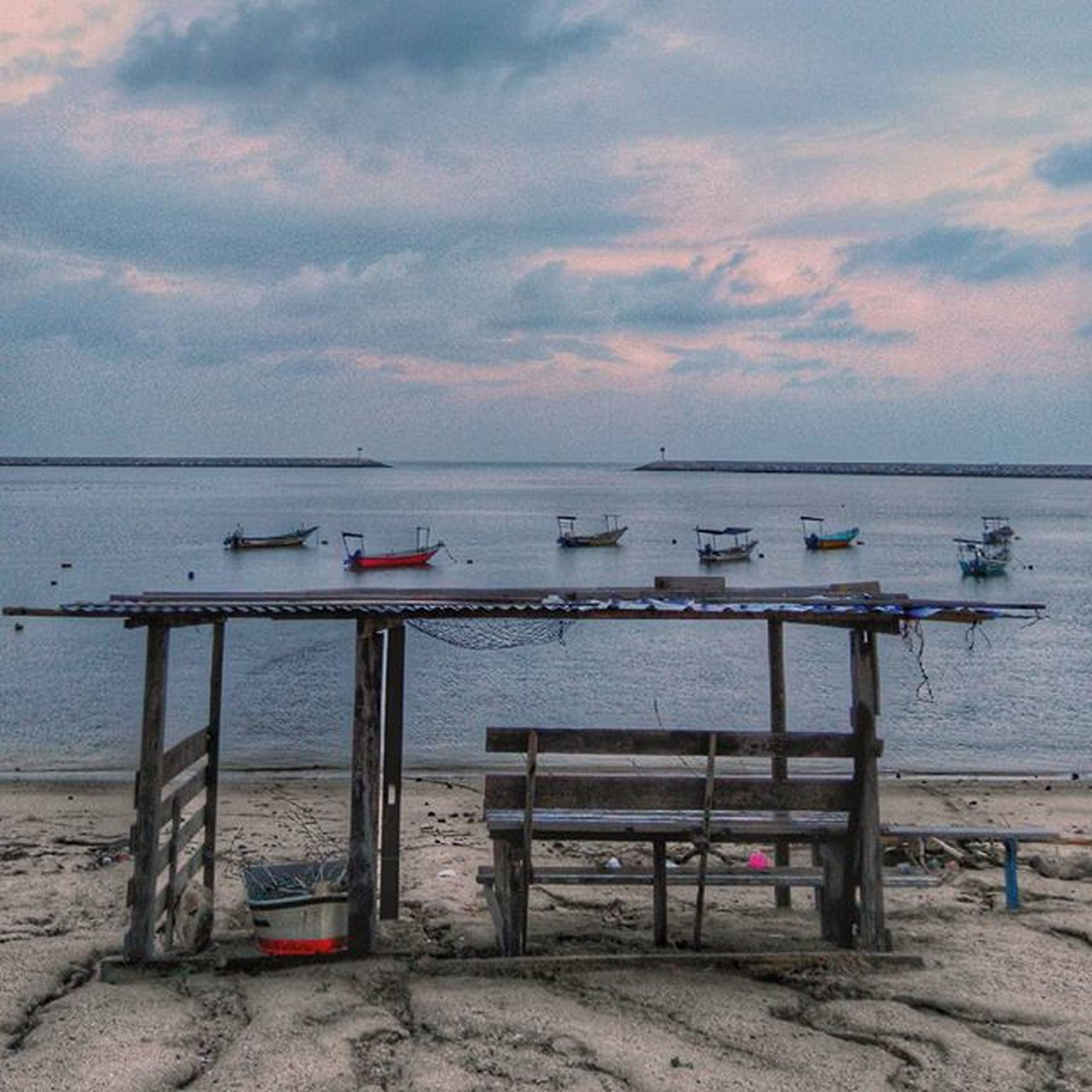 sea, horizon over water, water, sky, nautical vessel, beach, cloud - sky, transportation, boat, shore, moored, mode of transport, tranquility, tranquil scene, scenics, beauty in nature, nature, cloudy, sand, sunset