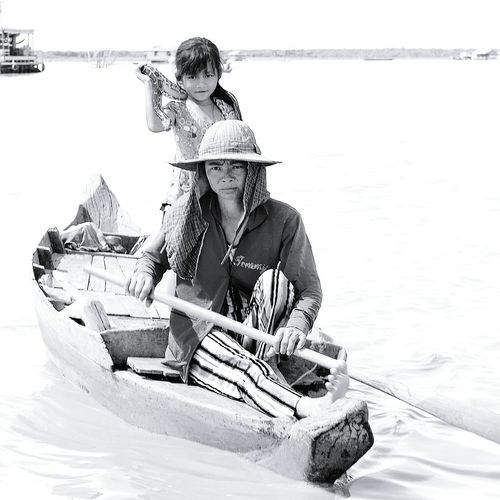 The girl with the snake. Poverty is widespread across the floating village at Tonle Sap lake in Cambodia. Villagers are desperate to earn a living from tourists by any means. First Eyeem Photo Begging Girlwithasnake Tonle Sap Lake Tonlesap Cambodia Floatingvillage Poverty Life As I See It