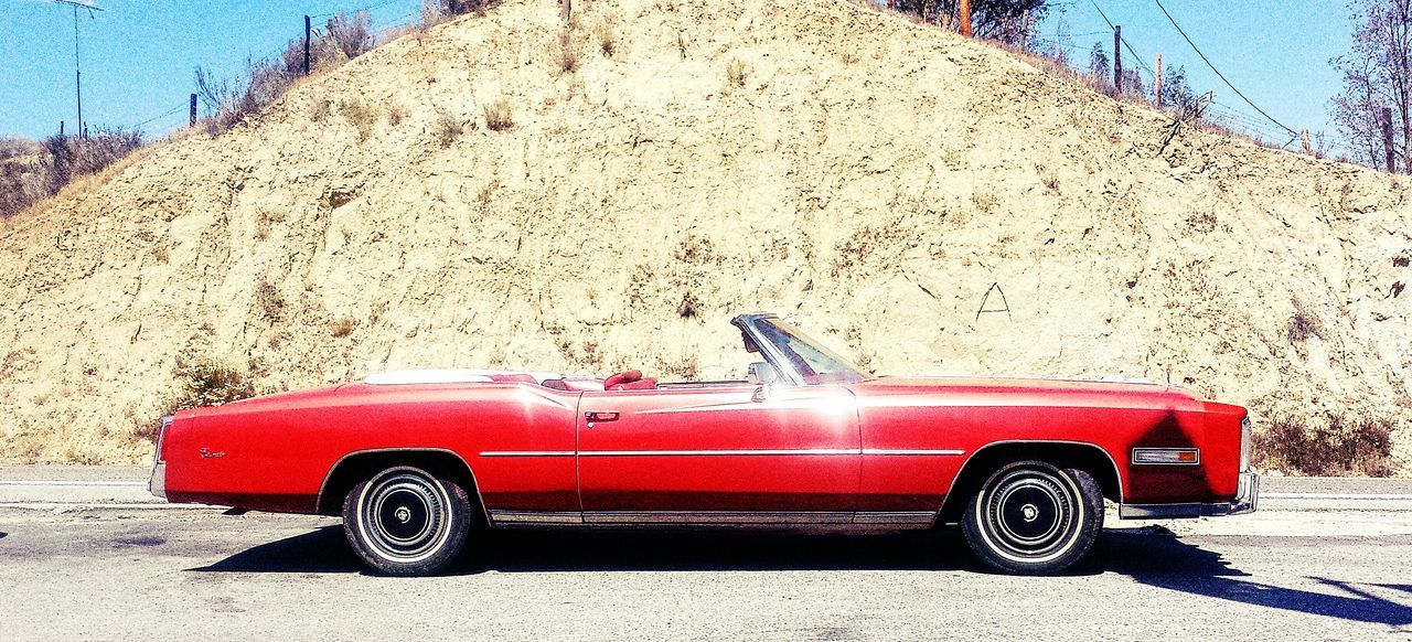 transportation, red, car, mode of transport, land vehicle, day, old-fashioned, outdoors, arid climate, no people, sky