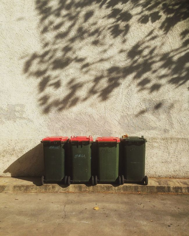 Bins & Shadows 02/06/16 Day Deterioration Factory Industry Leaves Light Light And Shadow No People Outdoors Pattern Rubbish Run-down Rural Scene Shadows Sky Stationary Street Photography Tree Trees Wall Fine Art Photography