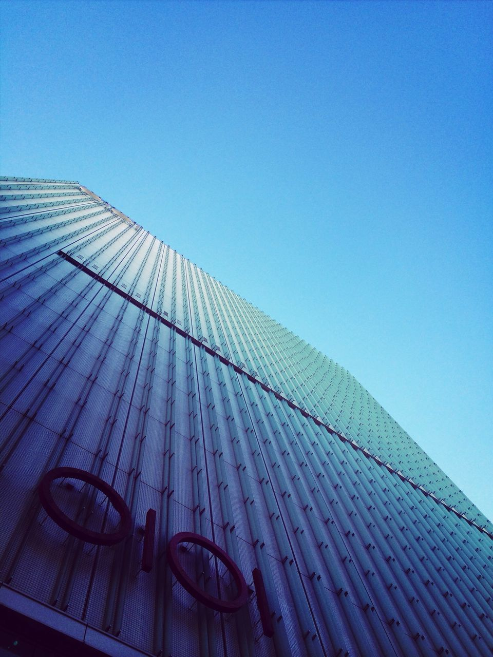 architecture, low angle view, built structure, building exterior, modern, growth, no people, day, skyscraper, blue, clear sky, city, outdoors, sky