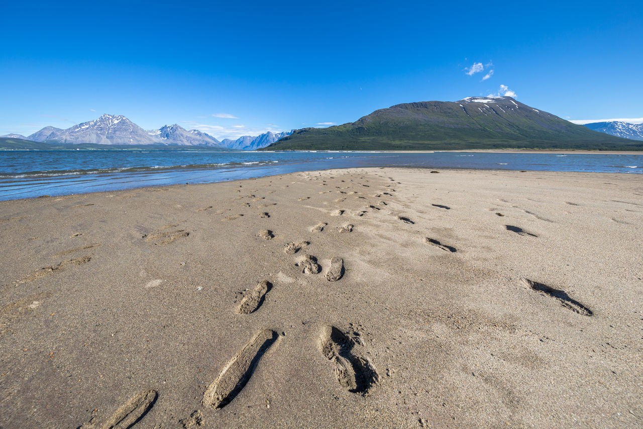 Arctic Beach Beauty In Nature Blue Sky Day Fjord Landscape Lyngen Lyngen Alps Lyngsalpene Mountain Nature No People Northern Norway Norway Outdoors Sand Sea Sky Track Tracks Tracks In The Sand Water Wave
