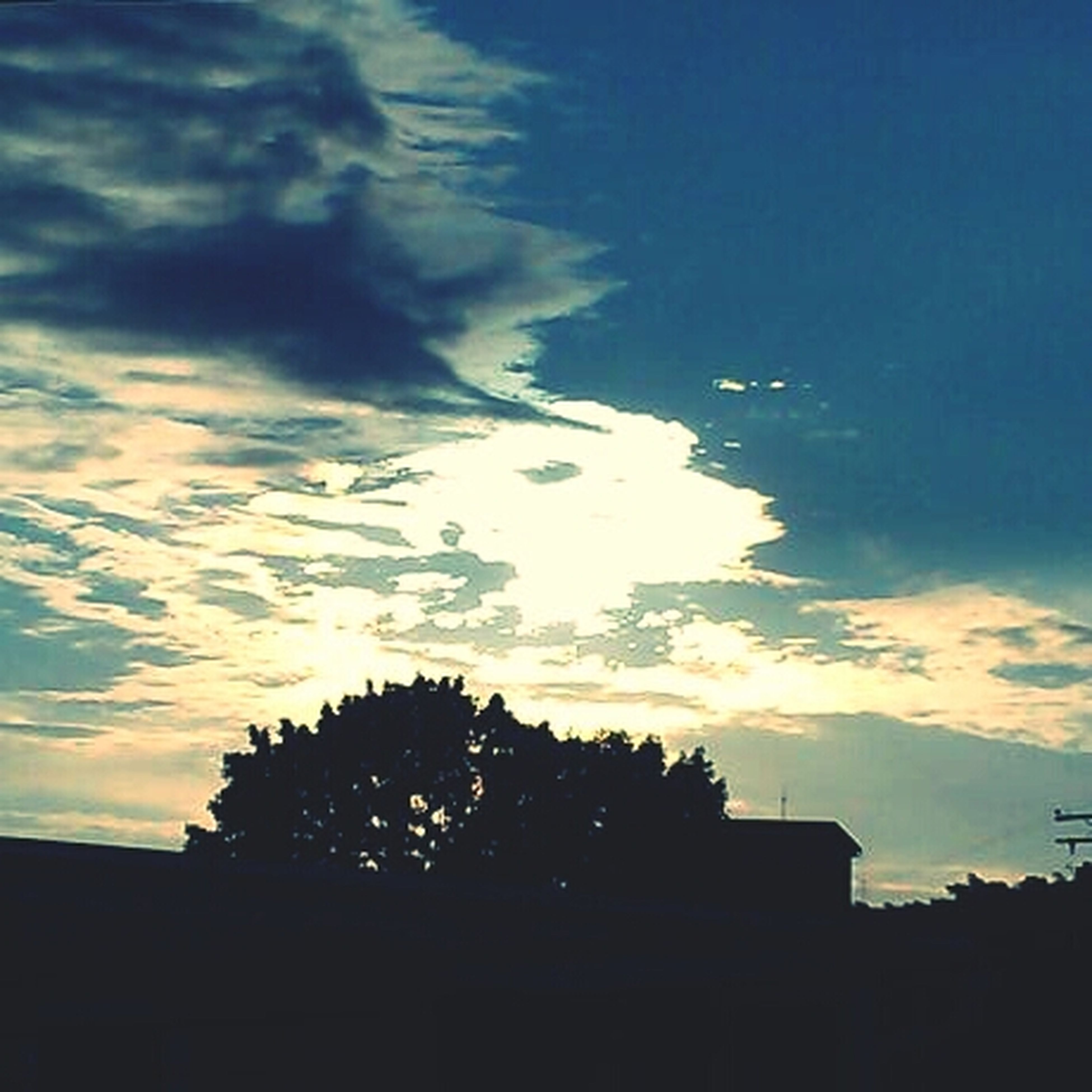 silhouette, sky, low angle view, building exterior, built structure, architecture, sunset, cloud - sky, tree, cloud, blue, dusk, nature, outdoors, house, building, cloudy, no people, beauty in nature, sunlight