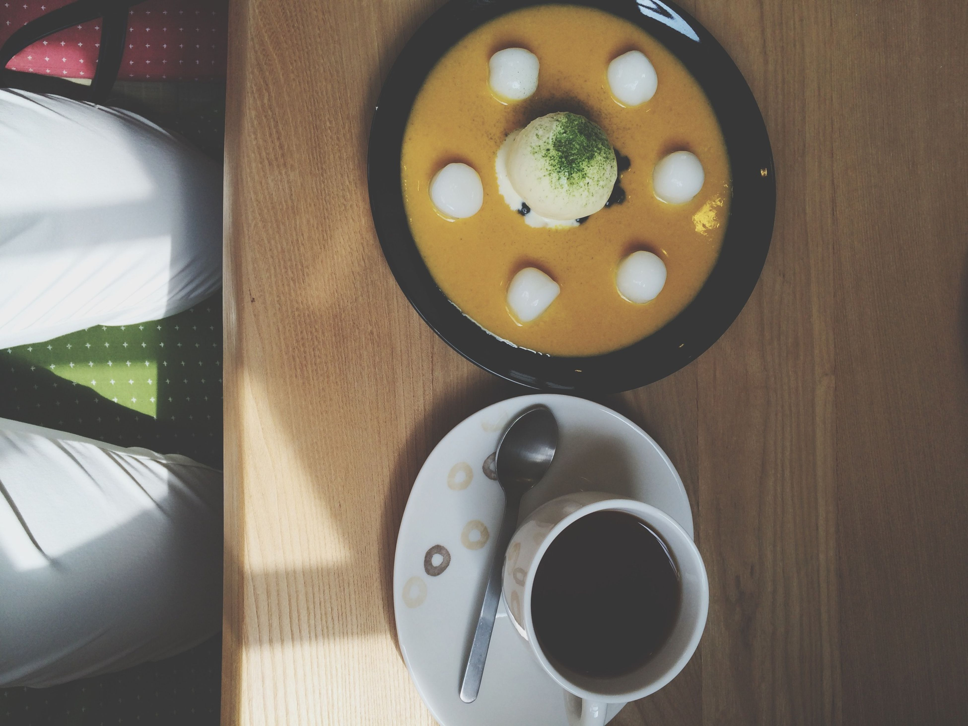 indoors, food and drink, table, high angle view, still life, directly above, plate, food, drink, freshness, circle, spoon, coffee cup, healthy eating, no people, wood - material, close-up, bowl, refreshment, saucer