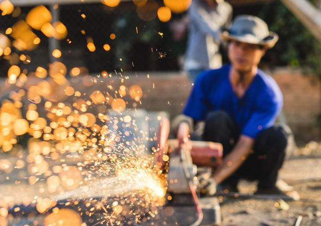 Eyeemphoto Have you ever took an amazing shot by accident? Photographing some construction workers, I was photo bursting this man sawing metal rods to pieces. In between burst it automatically adjusted focus and in result this was one of the frames I captured. I fell in love with it. Check This Out Hello World Taking Photos SONY A7ii Photography Portrait Photography Travel Photography Travel Portraiture Streetphotography Portrait Vietnam Vietnamese Worker Construction Selective Focus Sparks Photooftheday Amazing Adventure Moments No Way Jose Passion Share